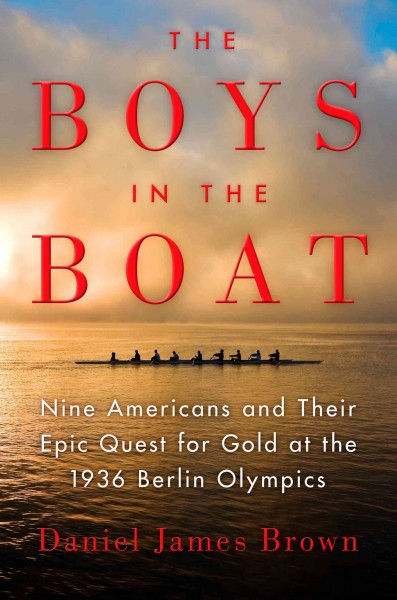 Boys in the Boat book cover. Still water and the silhouette of a small narrow boat with 9 figures seated in it.