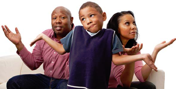 An African-American family shrugging their shoulders and making confused faces.